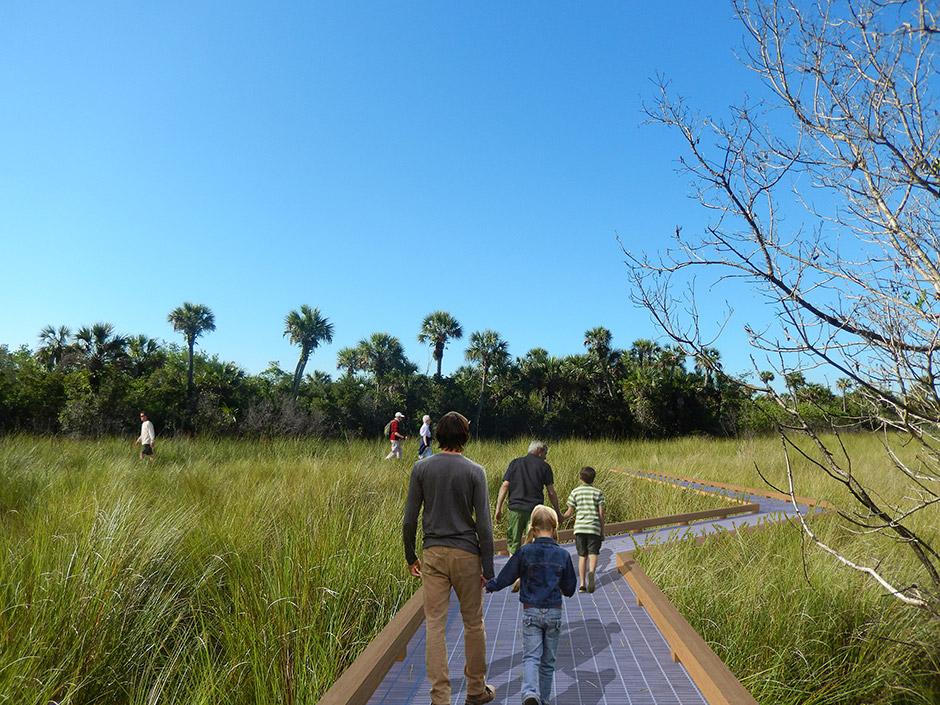 Metal boardwalk meandering through prairie grass.