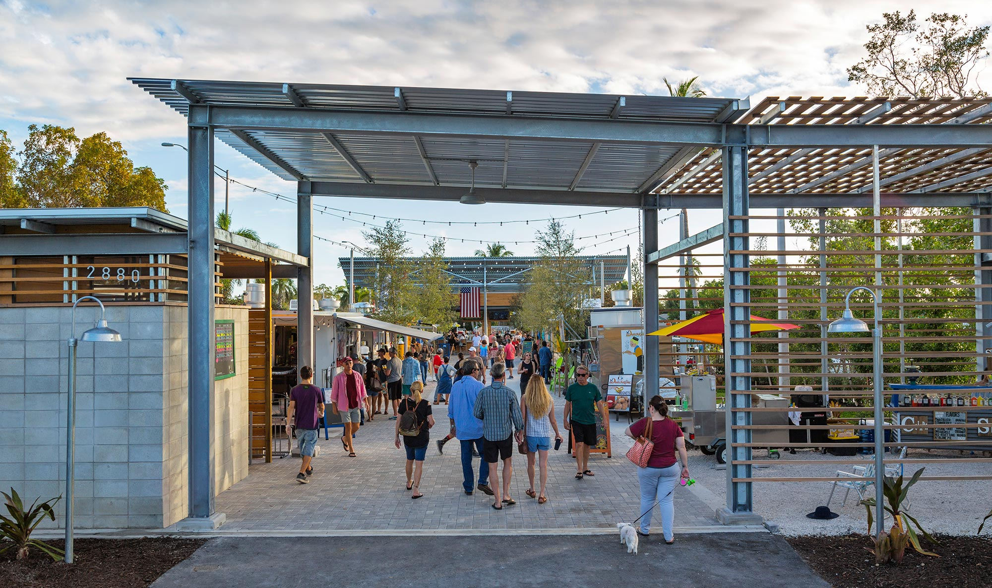 Main entry walkthrough under steel and wood structure.