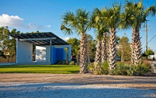 Band Shell with lawn and palm trees.