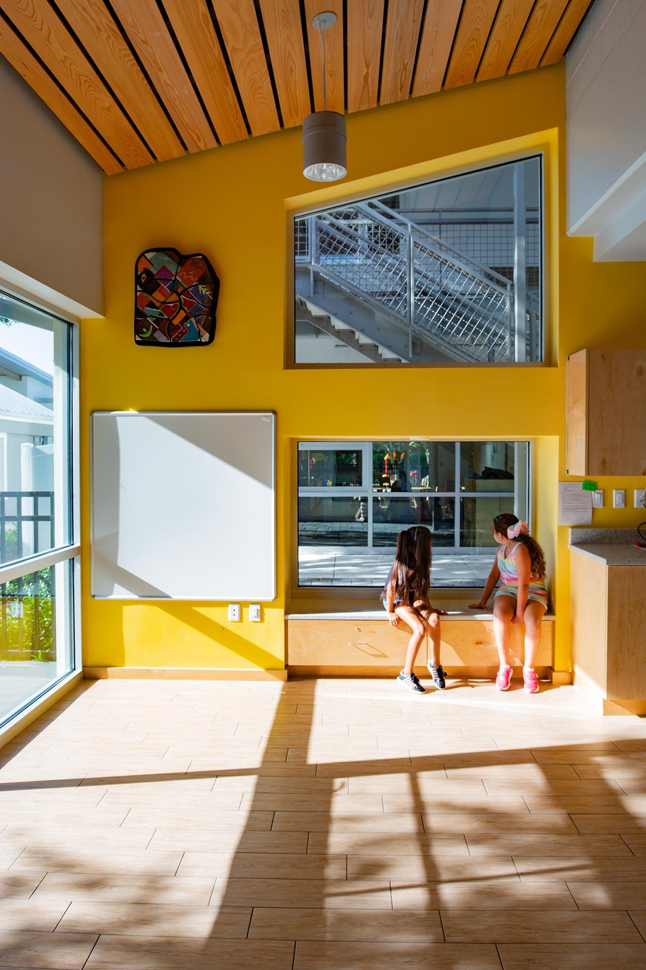 Built-in window seat in classroom.