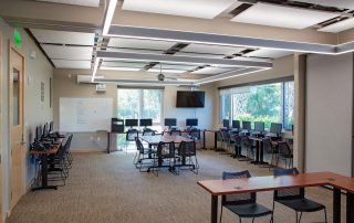Computer lab with tectum panel ceiling and modern light fixtures.