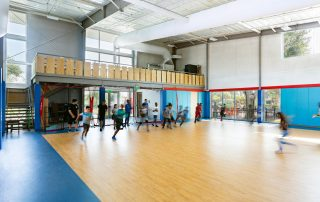Children playing in gymnasium.