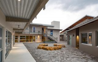 Courtyard between buildings with seating area made from local Florida keystone.