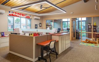 Open office with wood-framed windows and modern light fixture.