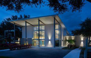 Multi-purpose building at dusk.