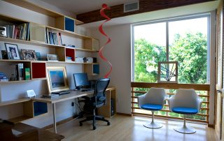 Office room with modern furniture and desk.
