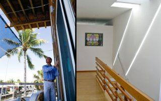 David corban seen adjusting fabric shade structure on deck.