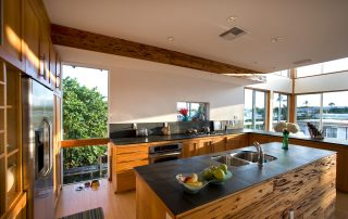 Kitchen with reclaimed wood cabinets and slate stone countertops.