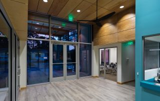 Lobby and waiting room with clear finished plywood ceiling design.