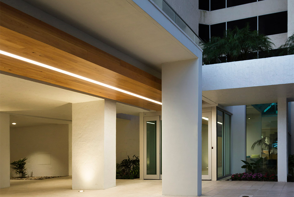 Renovated entry with wood ceiling and linear light feature