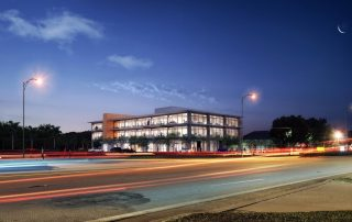 Rendering of building at dusk from across the street.