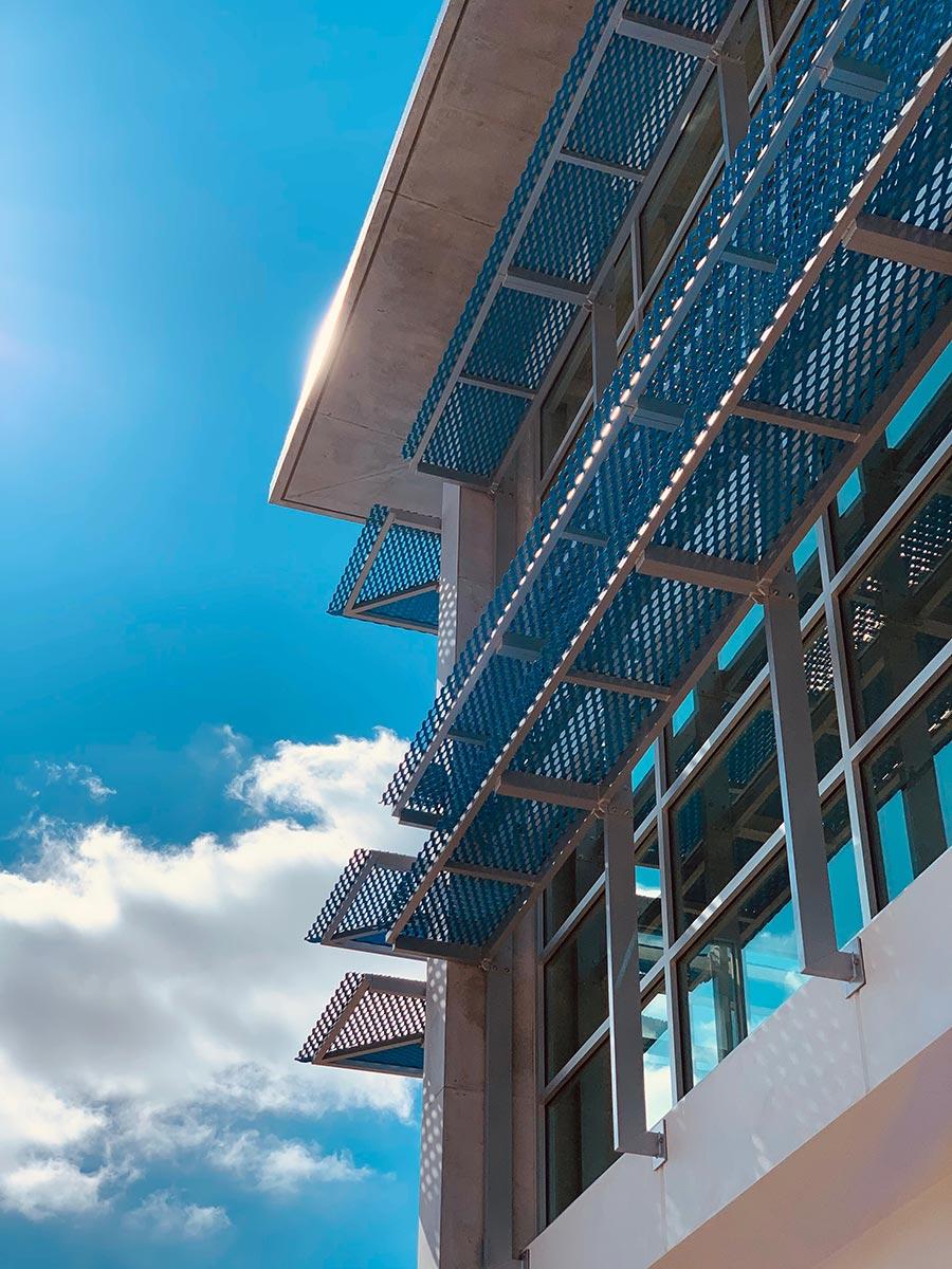 Sunshades on corner of building.