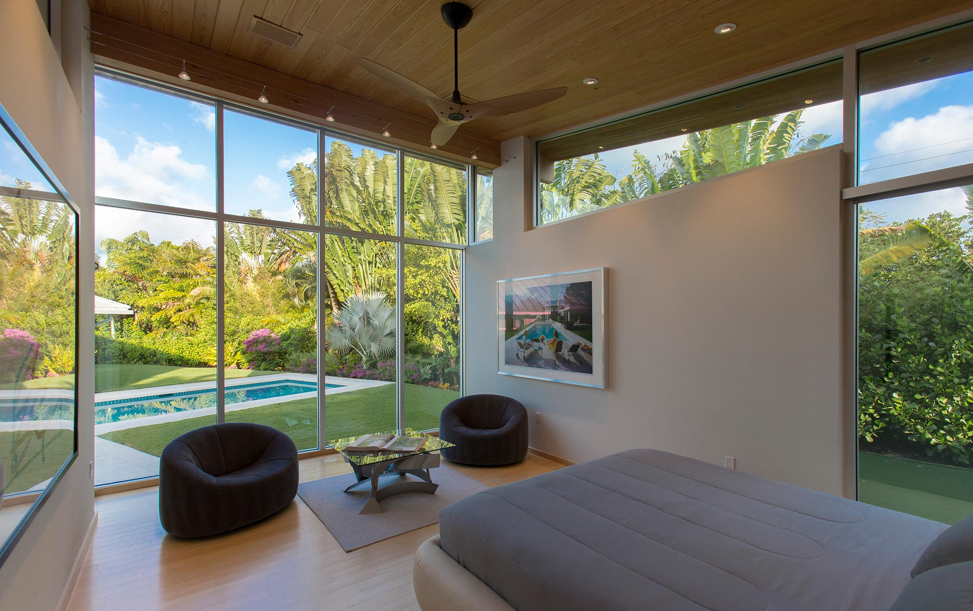 New master suite is positioned with a view to the new pool and private yard.