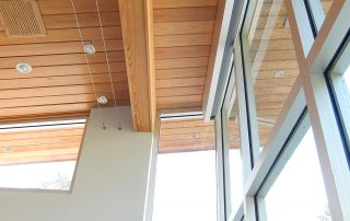 Wood tongue and groove ceiling with floor to ceiling windows.