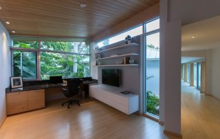 Study with custom desk and shelving.
