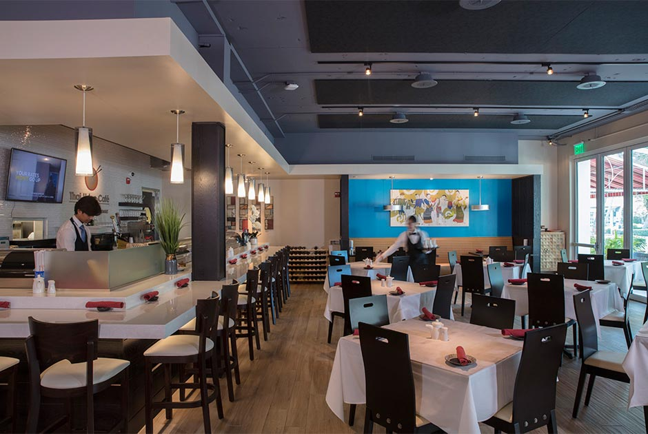 Sushi bar with server preparing tables