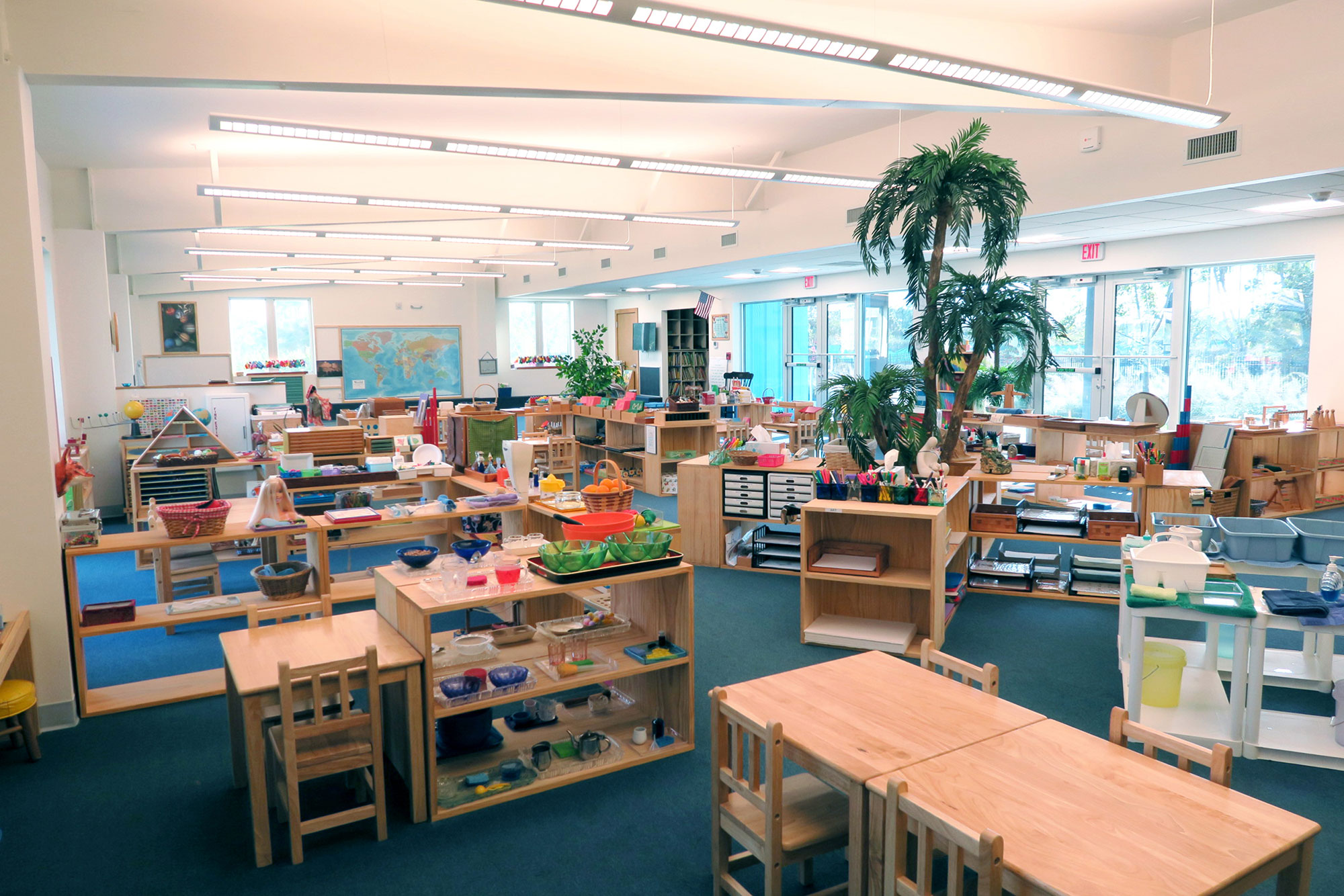 Typical classroom with children's furniture and bookcases.