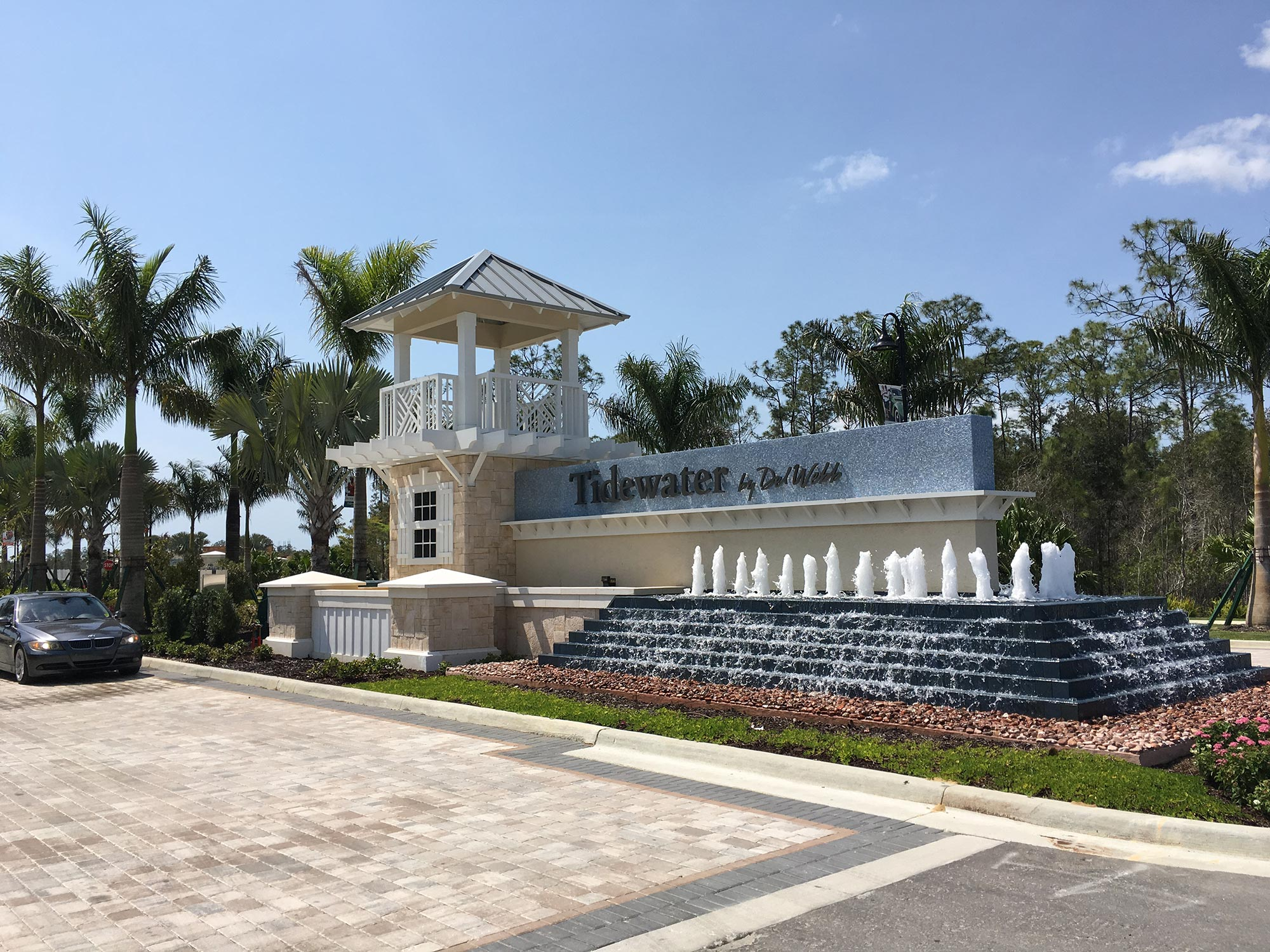 Sign with waterfall feature and similar architecture to clubhouse.