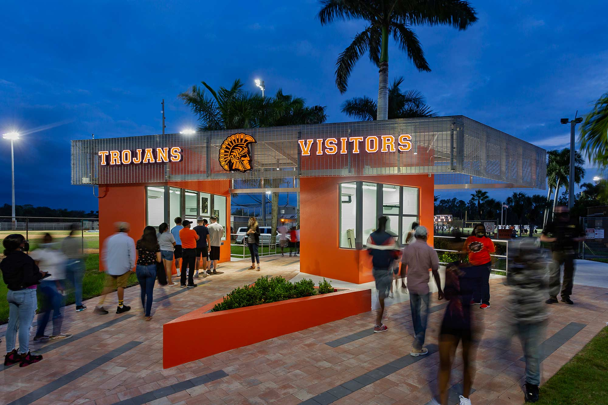 Main entry through ticket booths with home and away lanes.